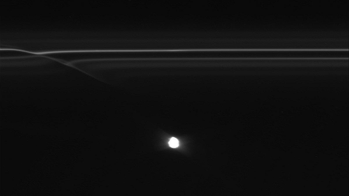 PASADENA, Calif. - Scientists working with images from NASA's Cassini spacecraft have discovered strange half-mile-sized (kilometer-sized) objects punching through parts of Saturn's F ring, leaving glittering trails behind them.